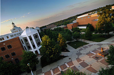 an_aerial_view_of_the_johnson_center_at_dawn